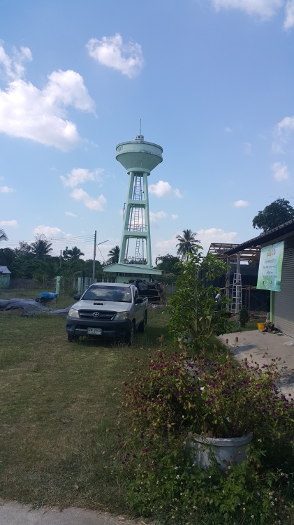 A water tank towers over San Pa Tong