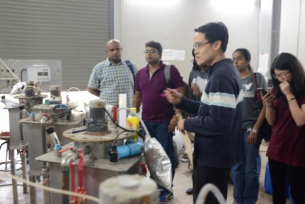 The team meeting with Engineering Professor from CMU, Prof Patiroop Pholchan, as he shows the biomass gasifier to generate energy from waste water