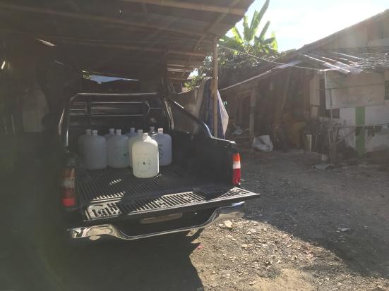 Village Scene at Ma Pu Kha - Reliance on Bottled Water
