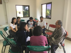 Group Three with their student guides from Chiang Mai University during the on-site interviews at a rice community centre on the outskirts of Chiang Mai.