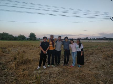 Team Members and CMU Student Ambassadors on a Rice Farm reflecting on the Field Work done in Chiang Mai