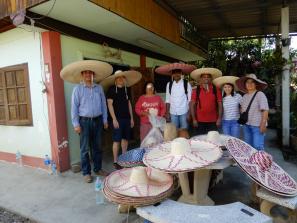 Self-sustaining livelihood through making straw hats.