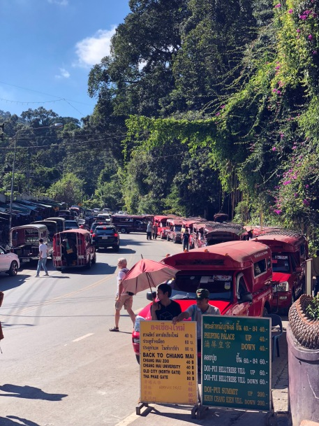 Rows of song teaws waiting to pick up passengers at the foot of the Doi Suthep Temple. While the red trucks hijacked the public transport scene in Chiang Mai, the government is not able to provide alternative solutions to the transportation issues in the city.